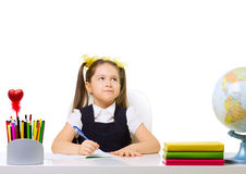 Schoolgirl at her desk Stock Photography