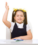 Schoolgirl at her desk Royalty Free Stock Photography