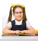 Schoolgirl at her desk Royalty Free Stock Photos