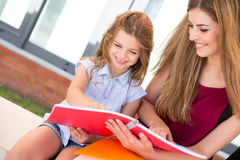 Schoolgirl and her mother Royalty Free Stock Photo