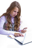 Schoolgirl and her netbook Royalty Free Stock Photos