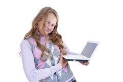 Schoolgirl with her netbook. Schoolgirl hold her white netbook Royalty Free Stock Photo
