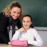Schoolgirl and her teacher Stock Image