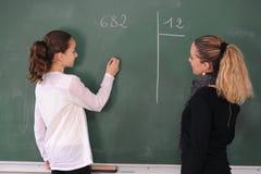 Schoolgirl and her teacher Royalty Free Stock Photos