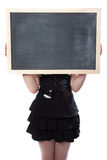 Schoolgirl hid behind a blackboard Stock Photos