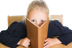 Schoolgirl is hiding behind a book Stock Image