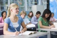 Schoolgirl in high school class Stock Images