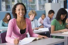 Schoolgirl in high school class Stock Image