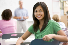 A schoolgirl in a high school class Stock Photography