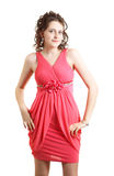 Schoolgirl high school girl wearing coral evening dress for prom in high school. A graduate of the school wore evening dress coral Royalty Free Stock Image
