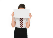 Schoolgirl holding a blank sign hiding her face Royalty Free Stock Photos