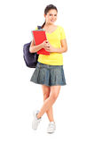 Schoolgirl holding books Royalty Free Stock Images