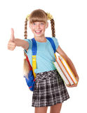 Schoolgirl holding books and showing thumb up. Royalty Free Stock Image