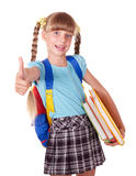 Schoolgirl holding books and showing thumb up. Royalty Free Stock Photo