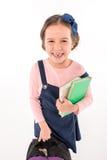 Schoolgirl holding books Stock Image