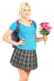 Schoolgirl holding a bouquet of flowers Royalty Free Stock Photos
