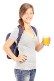 Schoolgirl holding a glass of orange juice Royalty Free Stock Photography