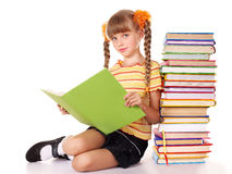 Schoolgirl holding pile of books. Stock Image