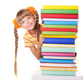 Schoolgirl holding pile of books. Royalty Free Stock Photos