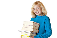 Schoolgirl holding school books and smiles happy Royalty Free Stock Image