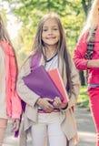 Schoolgirl in park stock photo