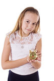 Schoolgirl holding small alarm clock on a white Royalty Free Stock Images