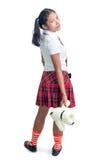Schoolgirl holding a teddy bear Stock Image