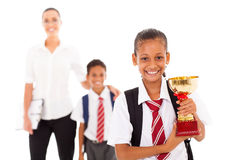Schoolgirl holding trophy Royalty Free Stock Images
