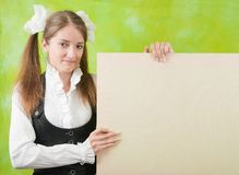Schoolgirl holds blank canvas Stock Photos