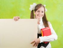 Schoolgirl holds blank canvas Stock Image