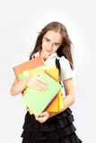 Schoolgirl holds books Royalty Free Stock Images