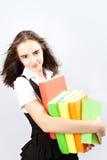 Schoolgirl holds books Stock Photos