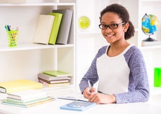 Schoolgirl at home Royalty Free Stock Images