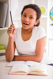 Schoolgirl at home Royalty Free Stock Image