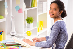 Schoolgirl at home Royalty Free Stock Photography