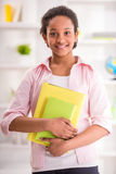 Schoolgirl at home Royalty Free Stock Photo