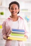 Schoolgirl at home Stock Photo