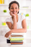 Schoolgirl at home Stock Photography