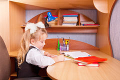 Schoolgirl with homework Royalty Free Stock Image