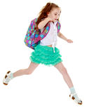 Schoolgirl jumping with a briefcase Stock Photos