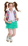 Schoolgirl jumping with a briefcase Royalty Free Stock Photos