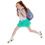 Schoolgirl jumping with a briefcase Royalty Free Stock Photo