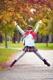 Schoolgirl jumping Stock Image