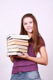 Schoolgirl keeps in hand books Stock Photography