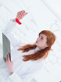 Schoolgirl laboratory analysis Royalty Free Stock Photography