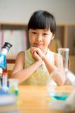 Schoolgirl at laboratory class Stock Image
