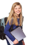 Schoolgirl with laptop smiling Royalty Free Stock Photos