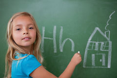 Schoolgirl learning the alphabet Royalty Free Stock Photo
