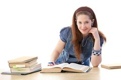 Schoolgirl learning at home smiling Royalty Free Stock Photography