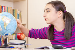 Schoolgirl learns geography Royalty Free Stock Photo